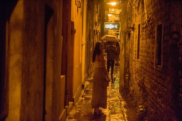 guest exploring old calcutta alleyways
