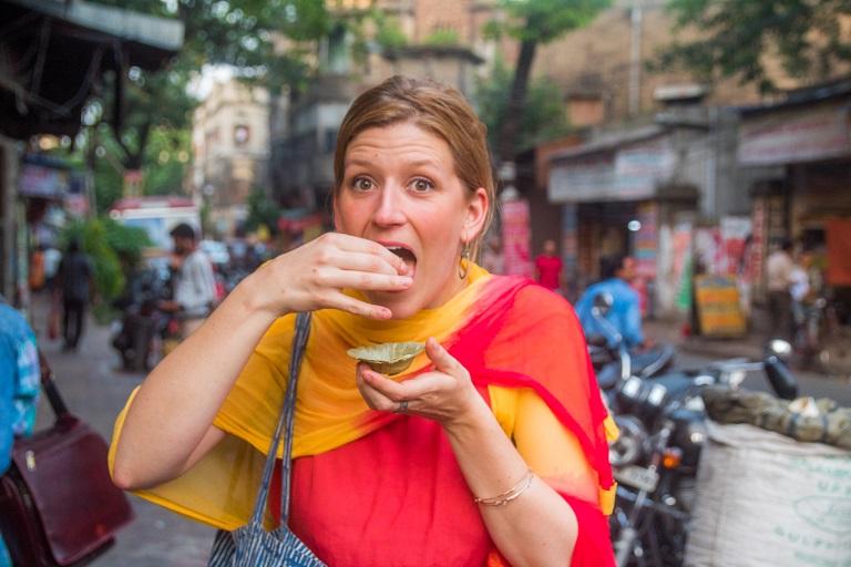 Tourist enjoying Street food on Alleyway Food Tour Kolkata