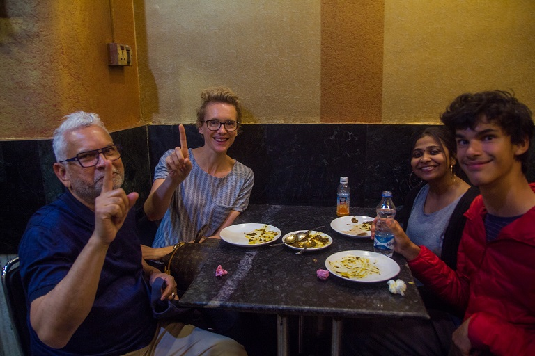 Guests guessing the no1 food item on the alleyway food tour calcutta