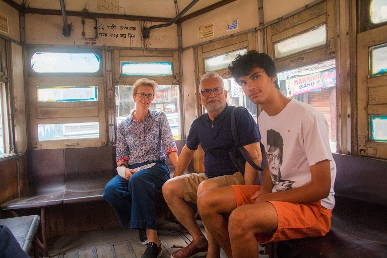 family enjoying tram ride with calcutta capsule
