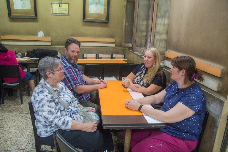 Guests enjoying 100 year old sweet shop in calcutta