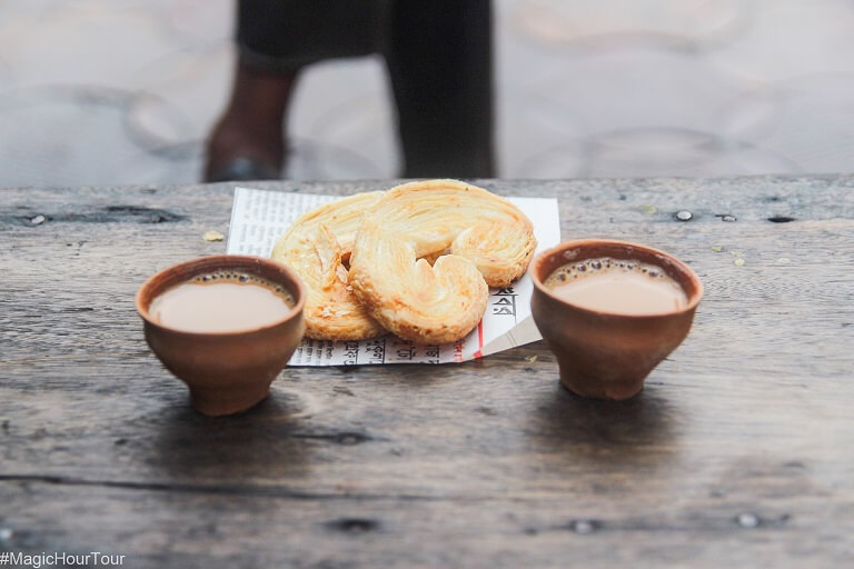 sipping on hot chai in earthen clay cups or bhaar on calcutta's best walking tour the magic hour tour.